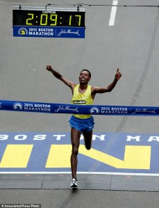 Lelisa Desisa, of Ethiopia, crosses the finish line to win the Boston Marathon, Monday, April 20, 2015, in Boston. (AP Photo/Charles Krupa)